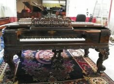 Civil War era square grand piano, F. C. Lighte Piano Company. Beautifully carved rosewood, Rococo Revival style, hand-carved cabinet. This kind of ornate piano were among the most expensive, highest grade square pianos available at that time – often selling for as much as a small house!
