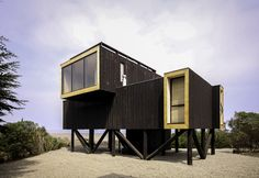 Stacked and rotated black volumes set on stilts make up Chilean seaside house Container Home Designs, Casas Containers, Building A Container Home, House On Stilts, Modern Cottage, Small Buildings, Timber House, Shipping Container Homes, Waterfront Homes