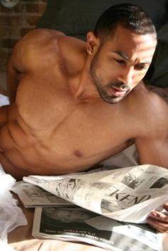 Sexy Black man reading.