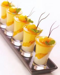 Mango Delight- – the king of fruits – mango will delight your taste buds with its intense flavour. This dessert made with panna cotta, mango cubes and mango mousse. It has a light flavour with soft texture. Mini Desserts, Just Desserts, Delicious Desserts, Dessert Recipes, Yummy Food, Plated Desserts, Apple Desserts, Dessert Shooters, Food Presentation
