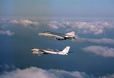 "A U.S. Air Force F-4D Phantom aircraft assigned to the 119th Fighter Wing ""Happy Hooligans"", North Dakota Air National Guard, intercepts a Soviet TU-95 Bear bomber aircraft over the Arctic Ocean, during a flight to Keflavik, Iceland in 1983."