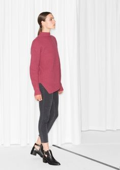 Knitted from a soft wool blend, this soft sweater has an asymmetric hem and a cosy turtleneck. $100