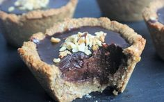 These tartlets may be small but they are packed full of a more flavor than most full sized tarts. The crust is made with coconut oil and hazelnut and then topped with a creamy date caramel and finished off with a rich, chocolate ganache.
