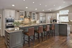 Slate grey cabinets. Love this kitchen set up.