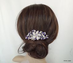 This vintage style hair comb has a flower bouquet brooch with clear rhinestones and purple velvet Swarovski crystals. Brooch has been placed on a