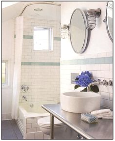 Nice bathroom. High window in the shower and the sink and stainless counter are particularly nice.