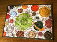 I love these placemats using fabric scraps- perfect for a sewing project to do with kids.