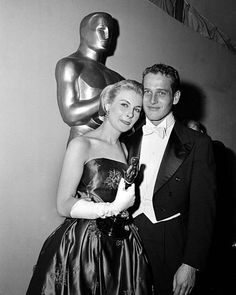 "Oscar-winning actress Joanne Woodward poses with her husband, actor Paul Newman, backstage at the 30th Academy Award presentations in Hollywood, Calif., March 26, 1958. Woodward won best actress for her role in the motion picture ""The Three Faces of Eve.""  (AP Photo)"