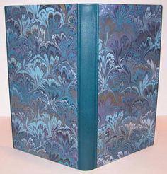 Sherry Barber.   Millimeter binding with French Chagrin spine and foredges, hand marbled papers by Catherine Levine on covers. 24.5 cm x 14.5 cm x 2.2cm. Bound 2005.