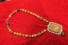 Pendant in Meenakari work with multicolored beads..