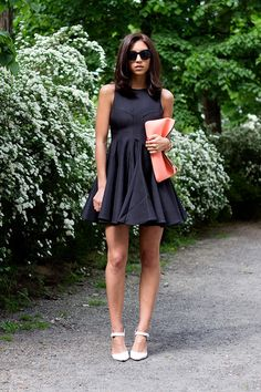 Dress up your LBD with a neoprene clutch. The modern fabrication is on-trend and super durable.