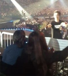 Chanyeol accepted the rose that his mother gave him. (gif) he's adorable
