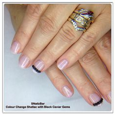 Colour change shellac with black caviar gems Turns cerise when cool