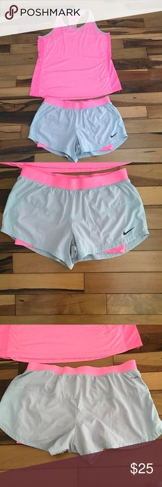 Nike dri-fit shorts Light grey running shorts with bright pink compression spandex built in. In great condition with matching top listed separately. Nike Shorts