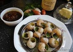 Escargots de Bourgogne (Snails in Garlic - herb butter), the very known dish from Burgundy.   http://www.saveur.com/article/Recipes/Escargots-Bourguignonne-Snails-in-Garlic-Herb-Butter