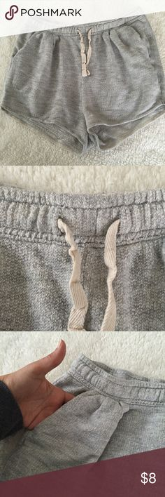 Sweat shorts Gray sweat shirts with elastic band and drawstring; two front pockets Shorts