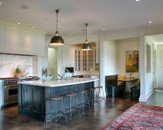 Black and white kitchen with stained concrete floors