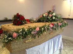 coffin flowers, funeral flowers, coffin garland, red rose coffin flowers,