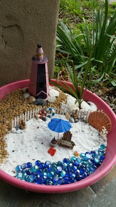 Fairy garden beach I put together. Chair pillars seagull wine bucket and red life preserver were mad