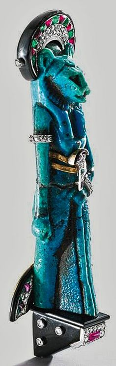 Faience Sekhmet ( Lion Goddess ) brooch with diamonds, rubies, emeralds and gold – Cartier Paris circa 1925 The lion goddess depicted in the fan brooch, dating to the 21st-22nd Dynasty 1075 BC. Original artifacts from Egypt were sometimes re-modeled into new pieces.