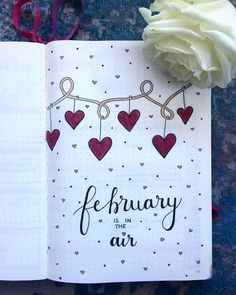 Bullet journal monthly cover page, February cover page, heart drawings, hanging heart drawings. | @herlettersandwords