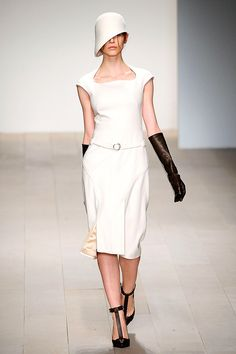 Black elbow length gloves omnipresent in Fall collections with modified cloche hat