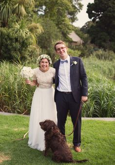 Fun shot with their dog!!! may have to get our dog rocky suited up on our wedding day!!! he will love it!!!