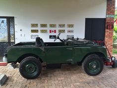 Land Rover 86 Serie One soft top at home garage. Nice