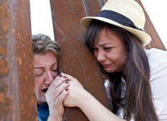 A girl holds her mother's hand who was deported. USA-Mexico