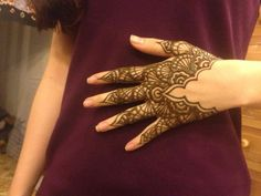 cool henna hand tattoo style -- starts far into the palm, and probably fades more evenly than a traditional full hand