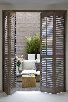 Lovely shutters open to one cozy patio.