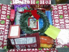 Holiday Care Package for My Man! Essentials:  Decorate the inside of the box with Christmas wrapping paper  An Ornament with our Picture in it!  Happy Notes with sweet, authentic words of encouragement  Wreath with a Jingle Bell  Hot holiday drinks, like peppermint or fireside rum coffees and hot chocolate  A mug (wrapped in bubblewrap, so it arrives in one piece)  Handwarmers if it's cold out there!  Snacks, Cookies, and Candies to fill up the box!