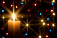 carols by candlelight - Card with a main light and sequence/glitter in the background.