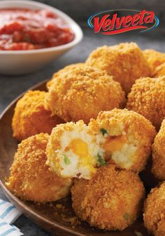 VELVEETA Potato Bites – As if your game day get-together isn't enough fun already, this appetizer recipe is sure to score big with the fans. Crunchy, popable potato balls with an ooey gooey, cheesy center. Touchdown!