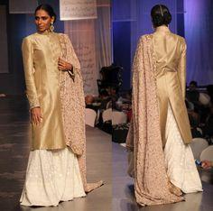 Manish Malhotra. Gold silk jacket teamed with an ivory chikankari sharara along with a peach georgette dupatta.