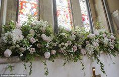 Pictures taken today show St Mark's Church in Englefield, Berkshire, filled with the beautiful white and pink blooms that Pippa and James left for the community to enjoy.