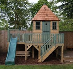 Wooden Playhouse On Platform With Slide - Project code: PC090464 by The Playhouse Company, via Flickr