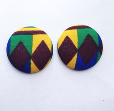 These are handmade African fabric earrings. The studded earrings are covered with fabrics on both sides, giving it a unique look.Medium size -3.8cm~ I N F O R M A T I O N ~ • note earrings are handmade so each earring may vary slightly.~ C A R E ~ • earring backings are securely attached but are still fragile so store your earrings with care.~ S H I P P I N G ~ • within 3-5 days of receiving payment. shipping times may vary during times of high demand.
