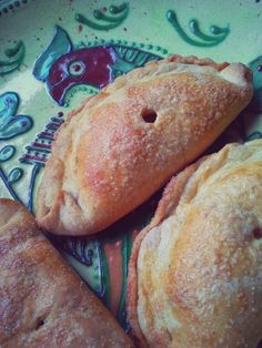 These are sweet filled empanadas using the recipe above. After brushing them with some egg wash, I sprinkle them with some turbinado sugar.