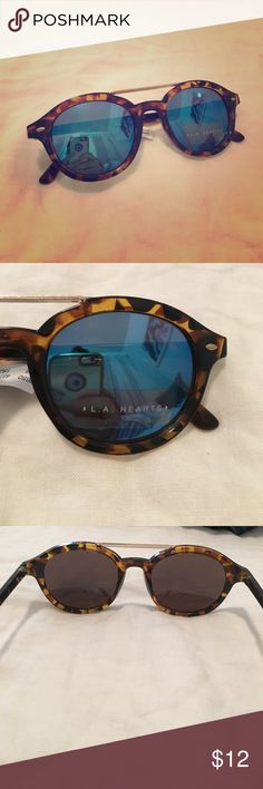 Pacsun L.A. Hearts tortoise sunnies New with tags, tortoise sunnies worth blue lenses and gold bar. PacSun Accessories Sunglasses