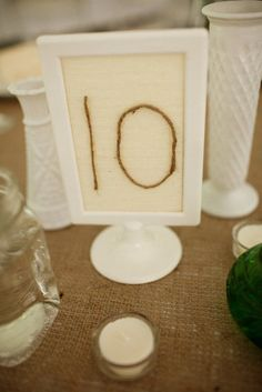 I could do framed embroidered numbers for the tables and that would be so easy and fun to make!