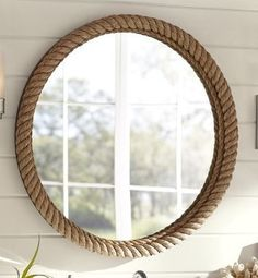 mirror- the mirror resembles a beach theme and the rope abound the mirror goes well with the rope cord that the lamp had