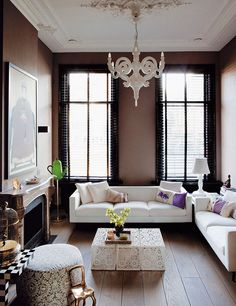 Brilliant use of white and chocolate brown colors. I love the chandelier.