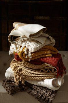 warm blankets stack still life