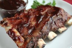 Used this basic method with st Louis ribs, Kansas rub and famous Dave's sauce once and liked the results.