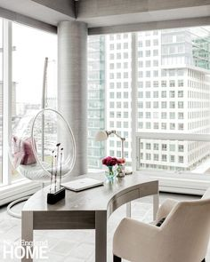 80b7c9ad9af A curved desk and Lucite bubble chair are clever foils for the square frame  of the