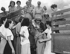 Arriving U.S. Army Nurses are excitedly welcomed by nurses that had been internees at Santo Tomas for the past 3 years, Manila, Philippines, Feb. 1945. #Nursebuff #Vintage #Nurse