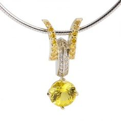Interlace Collection - 2.06ct Canary Tourmaline accented by Diamonds set in 18K White and Green Gold.