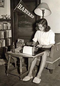 A student studies in her dorm room. Massachusetts, 1950s.