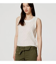 In summery linen cotton, we mixed a woven front and knit back - for a covetable composition. Jewel neck. Sleeveless. Crochet trim at neckline, armholes and side seams. Hi-lo shirttail hem.